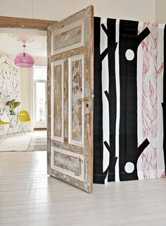 """EXCITING COMPLETION: From the dining room you see the kitchen with the pink Kartell ceiling light. Behind the """"Aarni"""" - the textile with wooden motifs is a fold-down guest bed. Guest Bed, Marimekko, Sofa Design, Beautiful Homes, Sweet Home, Dining Room, Ceiling Lights, Curtains, Interior"""