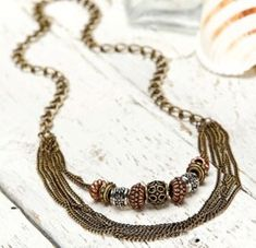 It's simple to make a brassy bronze necklace with copper and silver beads from Pat Catan's. Learn how to make this necklace, plus other jewelry projects.