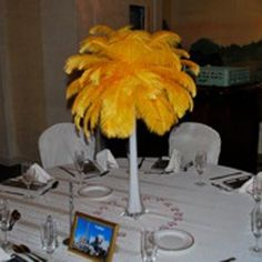 Beautiful and bright ostrich feather centerpiece with yellow ostrich feathers.