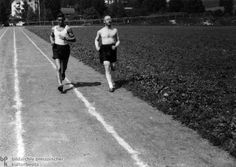 """Heinrich Himmler Trains for the Reich Sport Badge in Silver (1936)Prospective SS recruits had to prove their """"racial"""" purity and superiority through strenuous admissions and training procedures. Among other things, they had to demonstrate their exceptional physical and mental toughness. On a purely aesthetic basis, Himmler (right) preferred tall, blond, """"Nordic"""" types for the SS. He himself corresponded little to this physical ideal."""