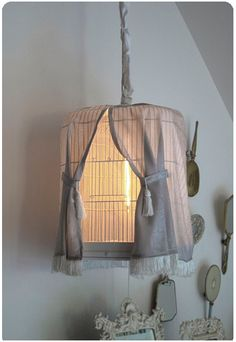 """DIY Night Light.  Constructed out of upcycled bird cage, with installed light and faux """"curtains""""."""