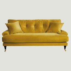 Amber yellow velvet sofa