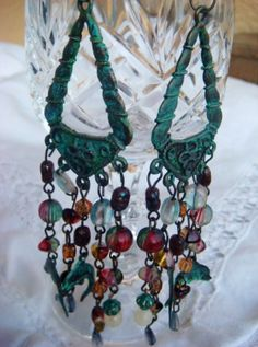 Earrings made with beads of glass,and Jade.  I used  several patinas to get the final colour. by Algeno Creations