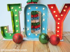 Cut open mache letters, poke holes for lights from the back. wow