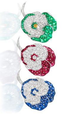 Two Platinum, Diamond, Ruby and Sapphire Pansy Clip-Brooches, by Oscar Heyman Bros., and Fancy Colored Yellow Diamond, Diamond and Emerald Brooch, Udall & Ballou Circa 1953