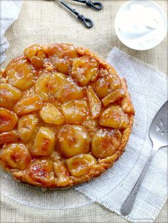 Autumn Apple Tarte Tatin - sweet apples cooked in gooey caramel on top of a flaky pie crust. But you actually cook it with the crust on top then flip it over!