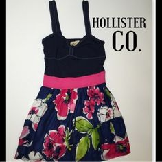 Hollister floral dress Navy hollister floral dress, with navy on top and hot pink on the skirt. The dress is 25 inches long and in EXCELLENT condition. Worn a few times but no wear or tear that I can see. Comes from a smoke free home. Size medium. Has 2 pockets in the front! no trades, feel free to ask questions, I'm happy to assist! Hollister Dresses