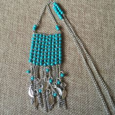 Turquoise Beaded Ladder Necklace Bohemian Jewelry Pretty turquoise long boho necklace with silver chain fringe & leaf charm accents.  24 inches in length with a two inch extension chain. Never been worn. Jewelry Necklaces