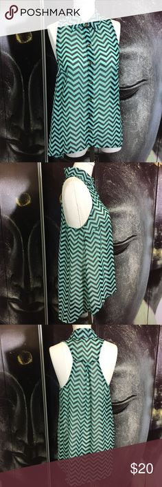 "TOSKA Mint and Black Chevron High Low Tank Top Super cute mint and black racerback chevron tank top! Pair it with your favorite white jeans! 100% polyester.   Measurements are approximate  Front: 22"" Back: 28"" Toska Tops Tank Tops"