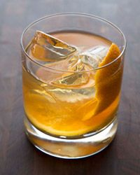 Maple-Bourbon Smash - 1/2 ounce pure maple syrup, preferably Grade A Dark Amber  1/2 ounce fresh orange juice  1/4 ounce fresh lemon juice  4 dashes of Angostura bitters  1/2 orange wheel  2 ounces bourbon  Ice  1 1/2 ounces chilled seltzer