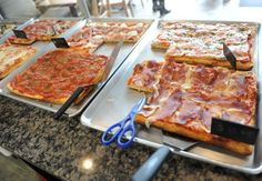A selection of pizzas is on display at Gravina Pizzeria in the Cos Cob section of Greenwich, Conn. Tuesday, April 7, 2015.  The pizzeria makes crsipy, light Roman-style pies available by the slice and weighed by the pound. Photo: Tyler Sizemore / Greenwich Time