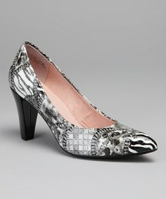 ce82ea900411d A sleek heel lifts this printed pump to fashionable new heights. Fierce  fashionistas will take center stage at any occasion wearing this wild  animal pair.