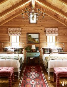 The east cabin bedroom, custom ikat benches sit at antique bed frames from Cathouse Beds.