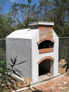 stucco and brick patio oven  Max would LOVE making pizzas in there