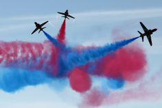 [D-Day Landing Sites Then And Now: 11 Striking Images That Bring The Past And Present Together]...  PORTSMOUTH, ENGLAND - JUNE 05: The Red Arrows display team perform over Southsea Common at the end of a commemoration service of the D-Day landings on June 5, 2014 in Portsmouth, England. (Photo by Dan Kitwood/Getty Images)