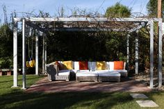 """Inspired by Schindler's sleeping porch at the landmark Kings Road House in West Hollywood, Ehrlich designed a steel trellis for the Inglewood backyard. Although Schindler used wood, Ehrlich opted for galvanized steel. """"We knew the grape arbor was going to grow over it, and we didn't want it to rot,"""" Ehrlich says. """"We also wanted it strong enough to hang swings and a hammock."""""""