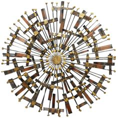 Jere-style Metal Sunburst Wall Sculpture | From a unique collection of antique and modern wall-mounted sculptures at http://www.1stdibs.com/furniture/wall-decorations/wall-mounted-sculptures/