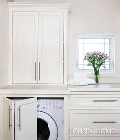 Great Idea for hiding the washer and dryer. I like the tall cabinet - it really adds storage.
