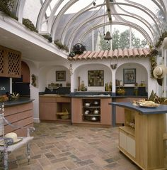 Spanish styled kitchen with tiled floor and glass cupola roof,