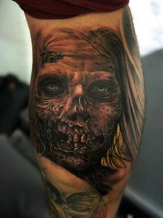 This tattoo is so lifelike you can almost imagine the stench from this undead fella.