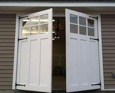 Swing out carriage doors.  www.wood-garage-doors.com