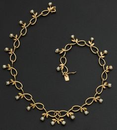 No provenance, date, or maker given. Beautiful piece somewhat reminiscent of Art Nouveau, but with a modern feel - Leigh ** Gold and pearl necklace from Heritage Auctions.