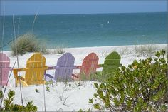 """Per this website, this picture """"...was taken on Sanibel Island off the coast of Florida in April. These apparently are famous chairs; the photographer writes, 'I found the postcard of these chairs in a gift shop, but never bought it. We were driving down the road & there they were on the beach! I jumped out of the car & got my pastel Adirondack chairs."""""""