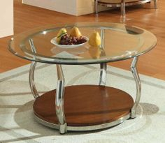 Wells Round Cocktail Table By Homelegance Furniture By Homelegance by Homelegance. $238.50. Modern Style. Chrome legs generously curve to feature cherry finished wood display shelves, as well as to provide circular support to the glass tabletops.. Smart, sturdy constrction. A contemporary take on traditional bombe styling, the Wells Collection adds flair to your living room ensemble. Chrome legs generously curve to feature cherry finished wood display shelves, as well as to ...