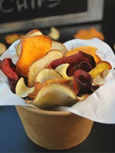Delicious and crispy homemade root vegetable chips that are just like Terra, only much healthier and cost up to 50% cheaper! Add some taro instead of potato :) Mmm!!