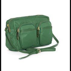 "Olivia + Joy Nylon Bag Beautiful green cross body bag. Three outer zip pockets. Two slip pockets and one zip on the inside. NWT Measures 6.5"" x 10"" x 3"". Olivia + Joy Bags Crossbody Bags"
