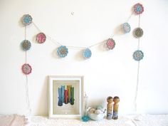 NEW crochet flower garland... Pearl - recycled yarn in coral, olive, aqua and oatmeal | Emma Lamb
