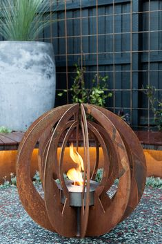 Metal outdoor sculpture / outdoor ethanol fire ball by http://www.entanglements.com.au/ Garden design by Paal Grant