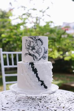 Black and white tiered wedding cake with hand illustrated florals // Top 10 Wedding Cake Creators in Malaysia - Part 2