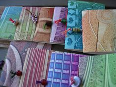 Mini books with several paste papers made by Hilde Debruyn