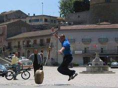 """The game of Vinchiaturo is something cheerer, in fact men competes in team by throwing large rounds of cheese of 15 km down the streets. This competition is called """"Lancio della Ruzzola"""". Cheese Game, Italian Traditions, Sandy Beaches, Competition, Medieval, Carnival, Street View, Italy, Traditional"""
