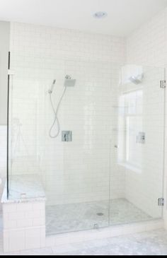 Master Bath built-in bench topped with marble - white subway tiles on the walls