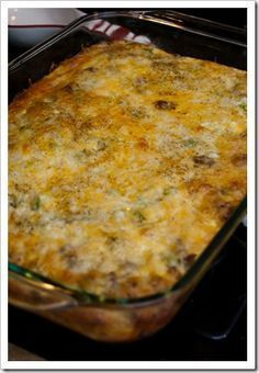 Breakfast Casserole --yep this is the one. To adjust add cream cheese to the sausage mixture and an additional can of crescent rolls to roll out on top. This is gonna be good.