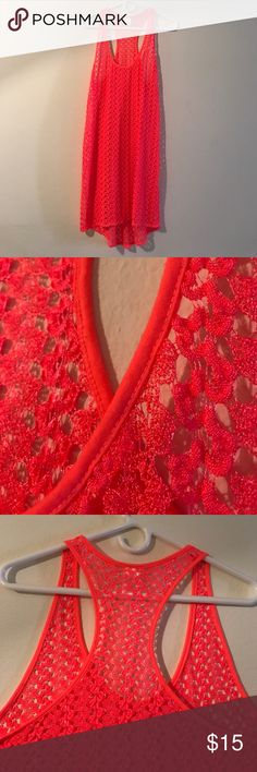 Swimsuit Long pull over This beautiful long cover-up looks bran new. It has no stains or snags in the material. It has a vibrant coral color. A great way to walk and sit pool side in fashionable comfort. Swim Coverups