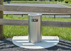 Nelson waterer mounted on a concrete pad in the pasture.