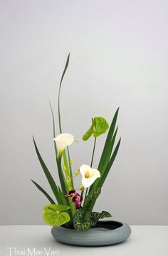 """Ikebana Vase-which means """"The Way of the Flower"""", an ancient Japanese flower arranging technique. I got a Ikebana vase  for Christmas from Frye Pottery. It looks very similar to this one."""