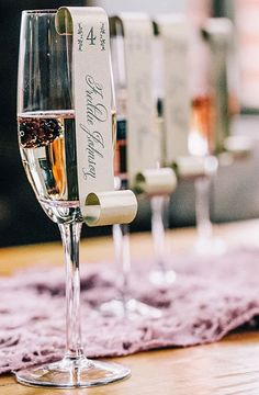 Wedding Idea We Love: Drinks That Double as Escort Cards. If you are looking to add a quirky and unique spin on your wedding: gorgeous Escort cards that your wedding guests will find entertaining and creative. #Champagne