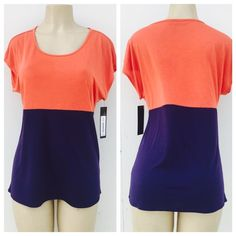 Gorgeous color block top Gorgeous color block top. Beautiful in person . 65% polyester  35% rayon . Also available in size L. Daisy Fuentes Tops Tees - Short Sleeve