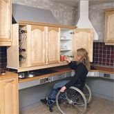 Wall cabinet that lowers and lifts for better accessibility. Watch the animation--amazing.