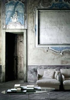 love this room of gray stone dark gray floor cream sofa and touches of blue