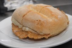 Bifana - The bifana is so popular in Portugal that McDonalds here have even launched the McBifana in recent times. So what is it? Basically a slice of pork steak in a roll of bread, the pork having been lightly sautéed, sometimes with garlic and/or other spices, so that the meat is warm and juicy.    Read more: http://www.lonelyplanet.com/travelblogs/157/173703/The+Bifana%3A+Portugal%E2%80%99s+Tasty+Meat+Snack?destId=360356##ixzz2HQT1TvR9
