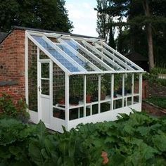 Attach greenhouse to southwest end of back porch that will be part of the kitchen one day.