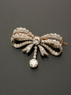 Art Deco Platinum and Diamond Bow-Knot Brooch  Circa 1920  Jewelry, Coins & Watches - Sale 1285 - Lot 117 - ADAM A. WESCHLER & SON, INC : AUCTIONEERS AND APPRAISERS - SINCE 1890