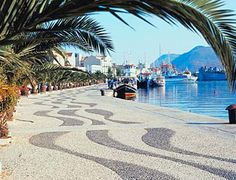 The main harbour of Argostoli, capital of Kefalonia, Greece. If you get down there early you can see turtles!