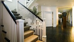 straight spindles vs curly ones; love post and black hand rail; floor color...