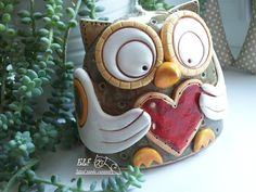 Ceramic Owl Holding a Heart